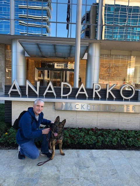 Mike and Subi pose by the sign outside Anadarko's Hackett Tower.