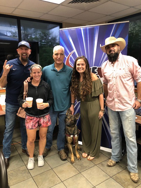 Mike, Wendy, and Subi pose with 100.3 The Bull's DJS (George, Mo and Cowboy Dave). Subi tilts her head towards the camera as she thinks I have heard these voices somewhere before.